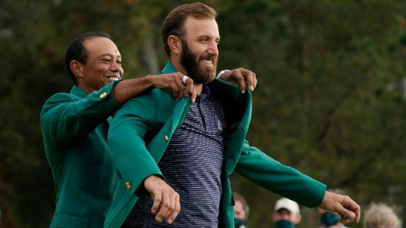 Tiger Woods helps Masters