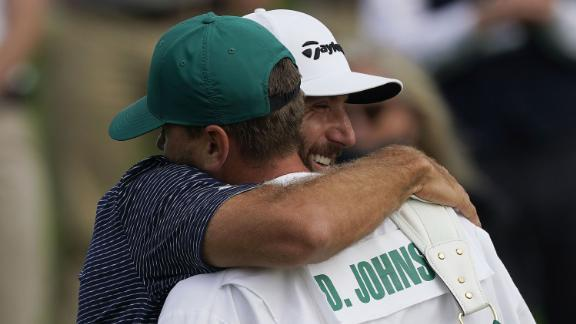Dustin Johnson of the US embraces his caddie and brother Austin Johnson after sinking his putt to win on the 18th hole during the final round of the 2020 Masters. After being delayed seven months by the coronavirus pandemic, the 2020 Masters Tournament was held without patrons 12 November through 15 November.