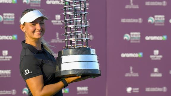 Danish golfer Emily Kristine Pedersen celebrates with the trophy after winning the Saudi Ladies International golf tournament on November 15, 2020, at the King Abdullah Economic City, north of Jeddah. (Photo by Amer HILABI / AFP) (Photo by AMER HILABI/AFP via Getty Images)