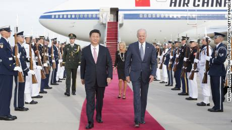 Chinese President Xi Jinping and his wife Peng Liyuan are welcomed by then-US Vice President Joe Biden and his wife at Andrews Air Force Base in Washington D.C. in 2015.