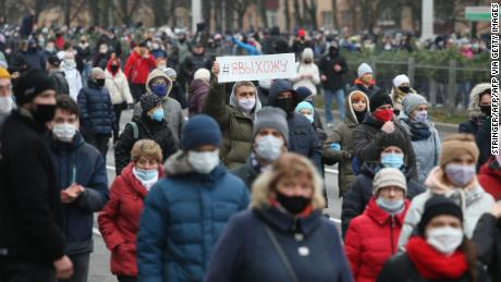 Belarus opposition supporters wearing face masks attend a rally to protest against the Belarus presidential election results in Minsk, on November 15.