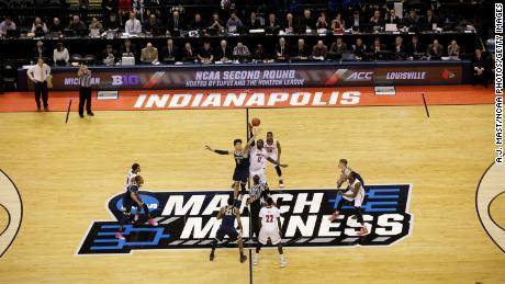 Tip off as the University of Michigan takes on the University of Louisville during the 2017 NCAA Men's Basketball Tournament held at Bankers Life Fieldhouse in Indianapolis, Indiana. The NCAA is currently in talks to hold this season's NCAA tournament entirely in Indianapolis.