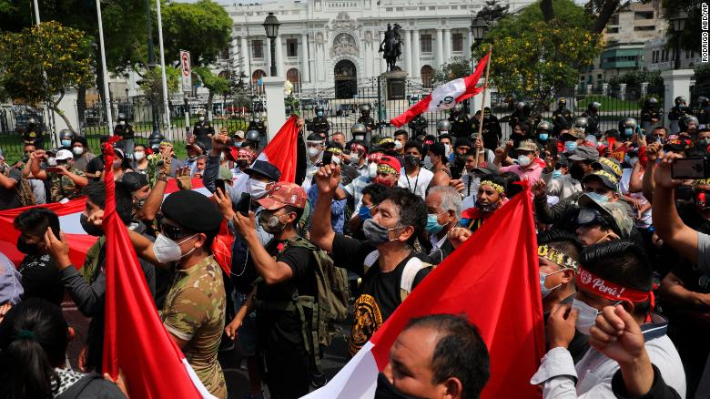 People demonstrate in favor of democracy and against corruption outside Congress in Lima, Peru, on November 16.