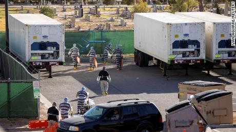 Inmates in El Paso, Texas, help move bodies to refrigerated trailers outside the El Paso County Medical Examiner's Office in Texas. Covid-19 cases have surged in El Paso.