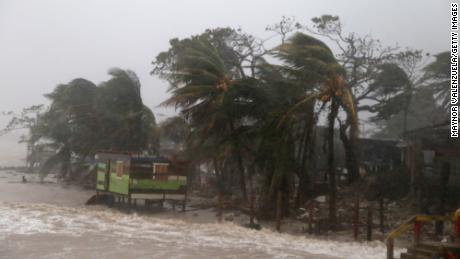 PUERTO CABEZAS, NICARAGUA - NOVEMBER 16: Palm trees blow by wind as Nicaragua prepares to receive hurricane Iota on November 16, 2020 in Puerto Cabezas, Nicaragua. Less than two weeks after being hardly affected by Hurricane Eta, villagers of Puerto Cabezas take precautions before landfall of Iota. Iota is the 13th hurricane of the season to hit the Atlantic coast and has already strengthened to category five, threatening the area with catastrophic winds and heavy rains. (Photo by Maynor Valenzuela/Getty Images)