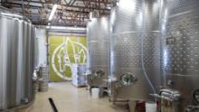 Meriwether Cider's Garden City, Idaho facility produces cider for bottling for direct-to-consumer takeaway sales and for wholesale to select grocers. It also includes a tap room for customers to come in for a drink.