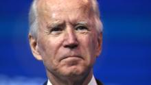 Joe Biden fires an early warning shot at Wall Street