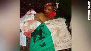 The body of Victor Sunday Ibanga is pictured in a pool of blood.