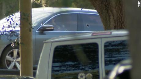 Bullet holes are seen in the windows of the car involved in the fatal shooting in Cocoa, Florida.