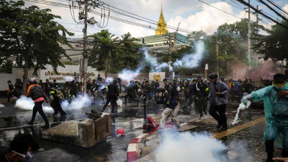 BANGKOK, THAILAND - NOVEMBER 17: Protesters react after police fired tear gas and water canon to try and disperse them outside Parliament on November 17, 2020 in Bangkok, Thailand. The demonstrators gathered outside parliament, on Tuesday, as the Thai government met to discuss amendments to the country's constitution. (Photo by Lauren DeCicca/Getty Images)
