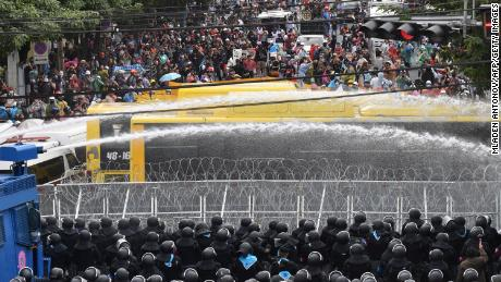 Police use water cannons to disperse pro-democracy protesters during a rally near the Thai parliament as lawmakers debate a charter amendment in Bangkok.
