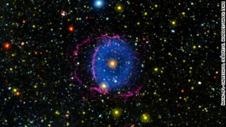 Star merger creates rare blue ring nebula