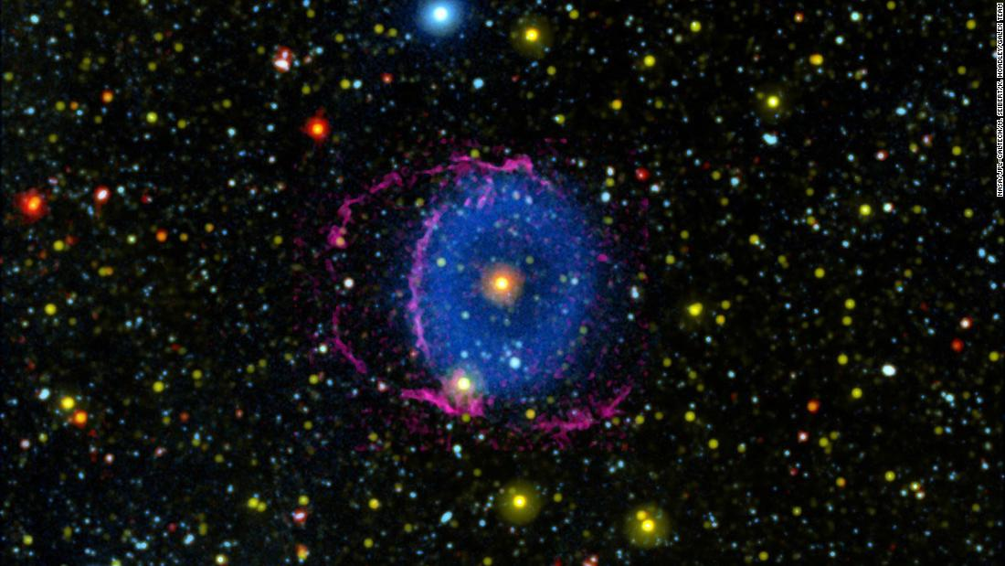 The Blue Ring Nebula is thought to be a never-before-seen phase that occurs after the merger of two stars. Debris flowing out from the merger was sliced by a disk around one of the stars, creating two cones of material glowing in ultraviolet light.