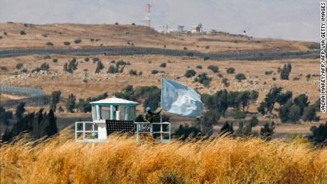 A UN peacekeeper stands on duty at an outpost of the United Nations Disengagement Observer Force (UNDOF) buffer zone between Syria and the Israeli-occupied Golan Heights on August 11, 2020.