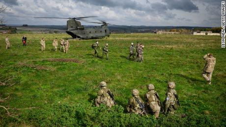 A CH-47 helicopter carries senior military personnel around the active area on the Ministry of Defence training area on Salisbury Plain, on October 14