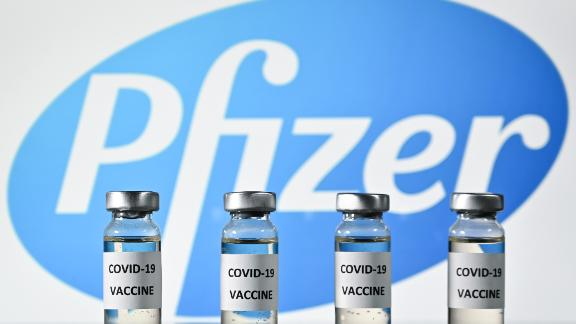 An illustration picture shows vials with Covid-19 Vaccine stickers attached, with the logo of US pharmaceutical company Pfizer, on November 17, 2020. (Photo by JUSTIN TALLIS / AFP) (Photo by JUSTIN TALLIS/AFP via Getty Images)