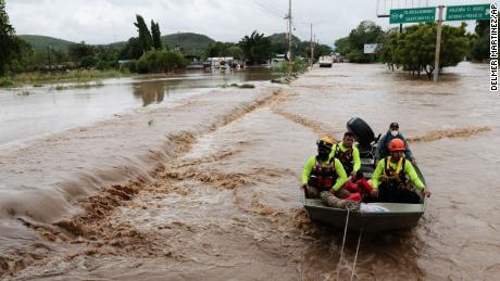 Ambulances are sailing on a flooded road after Hurricane Iota passed in La Lima, Honduras on Wednesday, November 18, 2020.