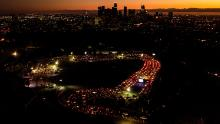 Motorists wait Wednesday in long lines to take a coronavirus test in a parking lot at Dodger Stadium in Los Angeles on November 18.