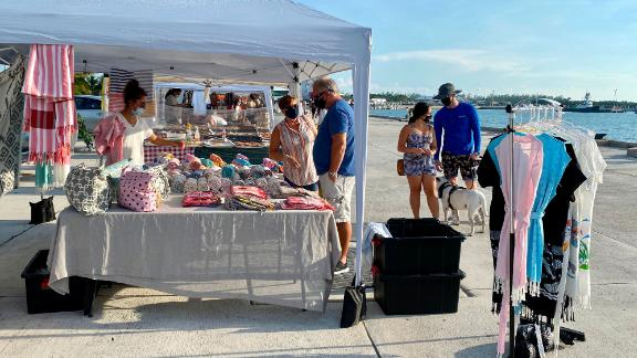 Customers and vendors are wearing masks at the Farmers Market in Key West, Florida on September 17, 2020 amid the coronavirus pandemic. (Photo by Daniel SLIM / AFP) (Photo by DANIEL SLIM/AFP via Getty Images)