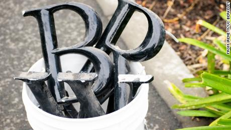 "Metal letters spelling Barrows Hall were removed Wednesday when the building was ""unnamed"" by campus officials."