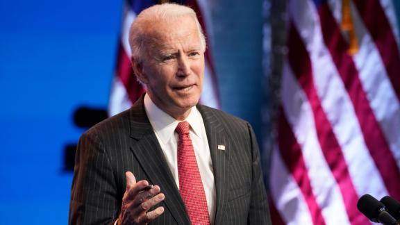 President-elect Joe Biden, accompanied by Vice President-elect Kamala Harris, speaks at The Queen theater, Thursday, Nov. 19, 2020, in Wilmington, Del.