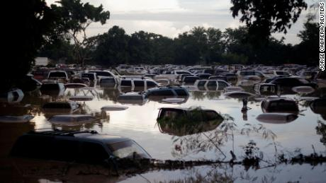 Vehicles submerged after heavy rain caused by Storm Iota, in La Lima, Honduras on November 19, 2020.
