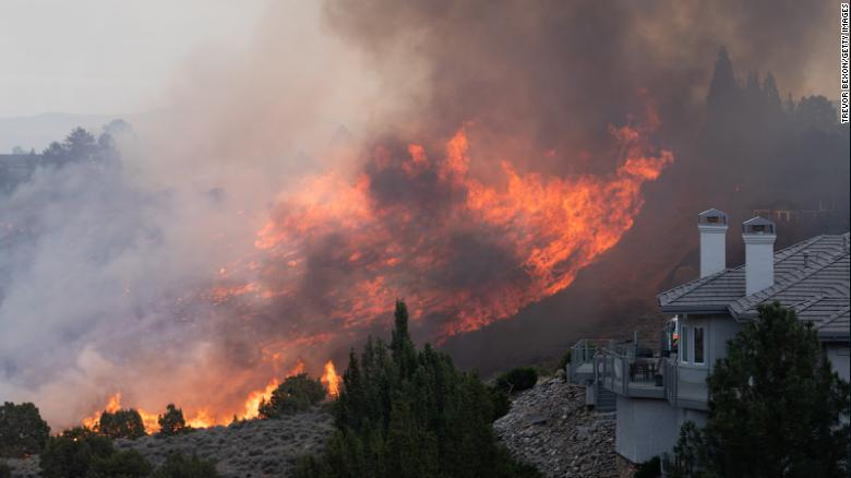 Wildfires in three states leave one dead and destroy thousands of acres