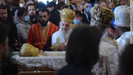 Patriarch Irinej pays respect to the Serbian Orthodox Church Bishop Amfilohije Radović  at his funeral in Podgorica, Montenegro on November 1.