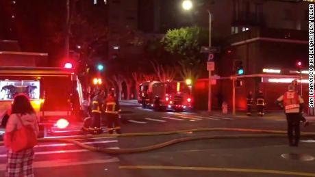 Firefighters work the scene of a three-alarm fire in San Francisco early Friday morning.