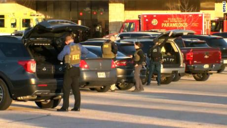 Police officers respond to the shooting at Mayfair Mall in Wauwatosa, Wisconsin.