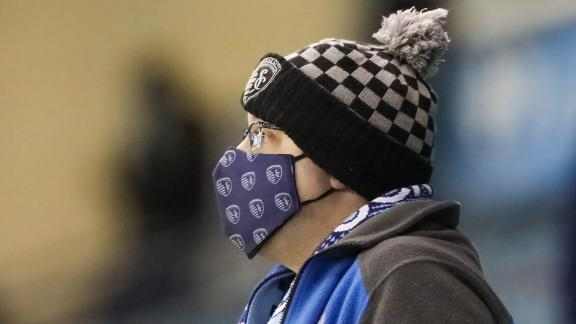 KANSAS CITY, KS - OCTOBER 24: A Sporting Kansas City fan wears a mask and tries to stay warm on a cold night on October 24, 2020 at Children's Mercy Park in Kansas City, KS.  (Photo by Scott Winters/Icon Sportswire via Getty Images)