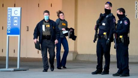 Police and FBI agents investigate the shooting at Mayfair Mall in Wauwatosa, Wisconsin, on Friday.