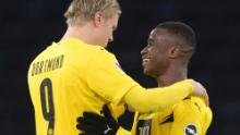 Haaland, left, and Moukoko hug each other after the end of the game against Hertha Berlin.