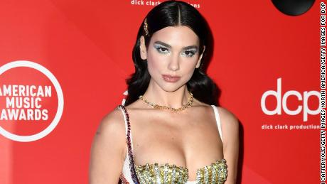 LONDON, ENGLAND - NOVEMBER 22: In this image released on November 22, Dua Lipa poses for the 2020 American Music Awards, broadcast on November 22, 2020 in London, England. (Photo by Gareth Cattermole/Getty Images for dcp)