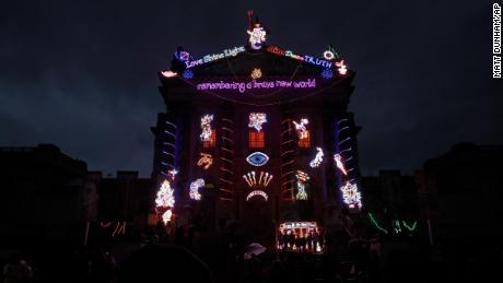 The exterior of the Tate Britain art gallery in London is lit up by neon lights to mark Diwali on November 14.