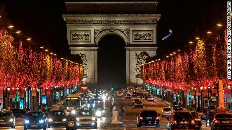 A picture shows a general view of the Champs-Elysees Avenue and the Arc de Triomphe after the inauguration of the Christmas season lights on November 22, 2020, in Paris. (Photo by STEPHANE DE SAKUTIN / AFP) (Photo by STEPHANE DE SAKUTIN/AFP via Getty Images)