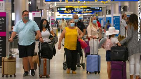 Masks are critical to stopping coronavirus spread, even at home, CDC says
