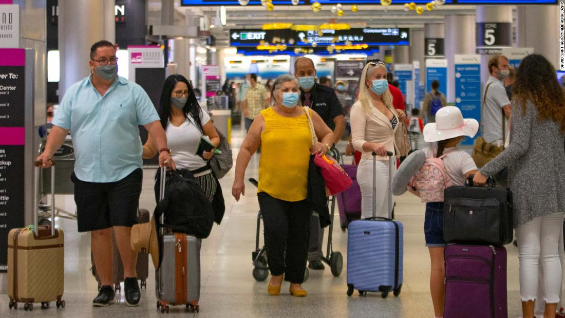 Americans continue holiday travel despite case surge