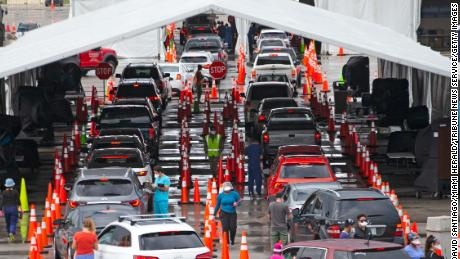 Vehicles line up this month at a drive-thru coronavirus testing center in Miami Gardens, Florida.