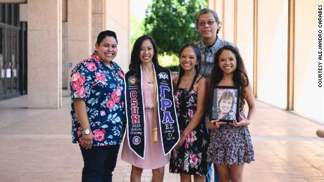 When Tiffany Olega graduated from college in May, her mom wasn't there to celebrate. Intead, her family posed with a framed photo of her. Rosary Castro-Olega, a nurse, died in March after contracting coronavirus.