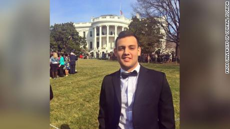 Alex Alvarado is a Republican political strategist, former congressional trainee, pictured in front of the White House.
