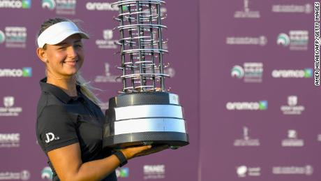 Pedersen celebrates with the trophy after winning the Saudi Ladies International