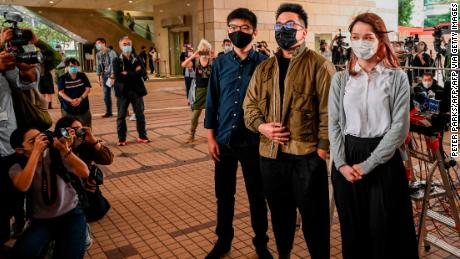 Pro-democracy activists Joshua Wong, Ivan Lam and Agnes Chow arrive for their trial at West Kowloon Magistrates Court in Hong Kong on November 23, 2020.