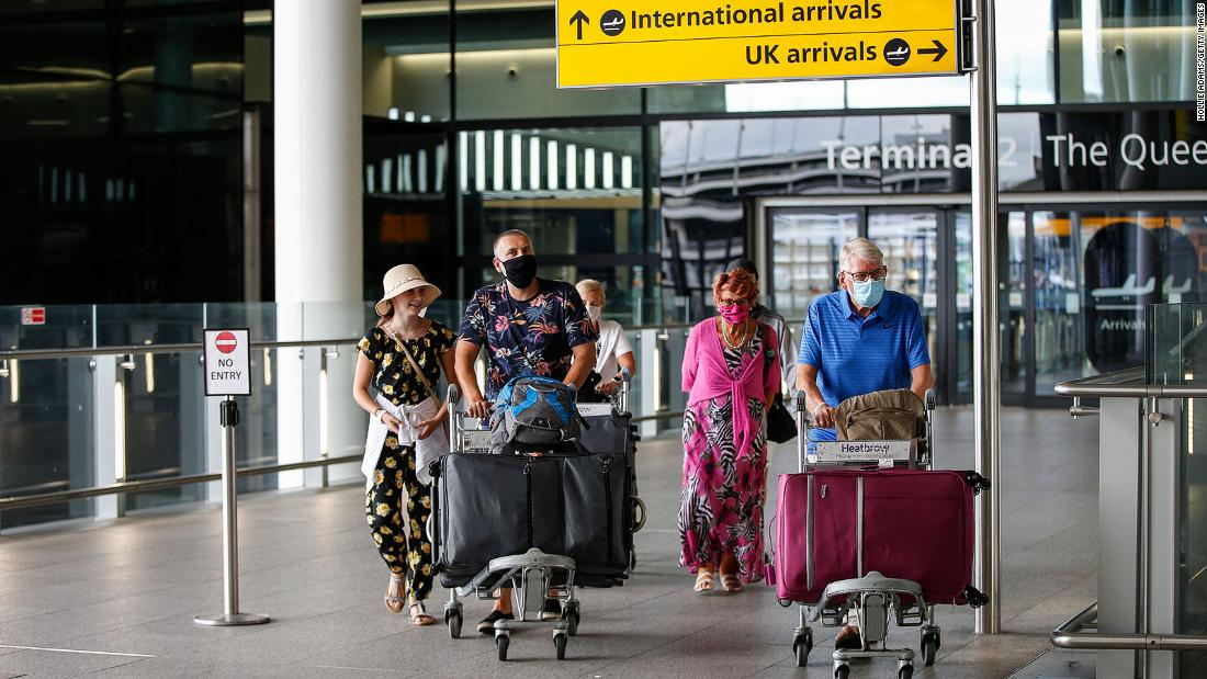 England cuts traveler quarantine period to five days