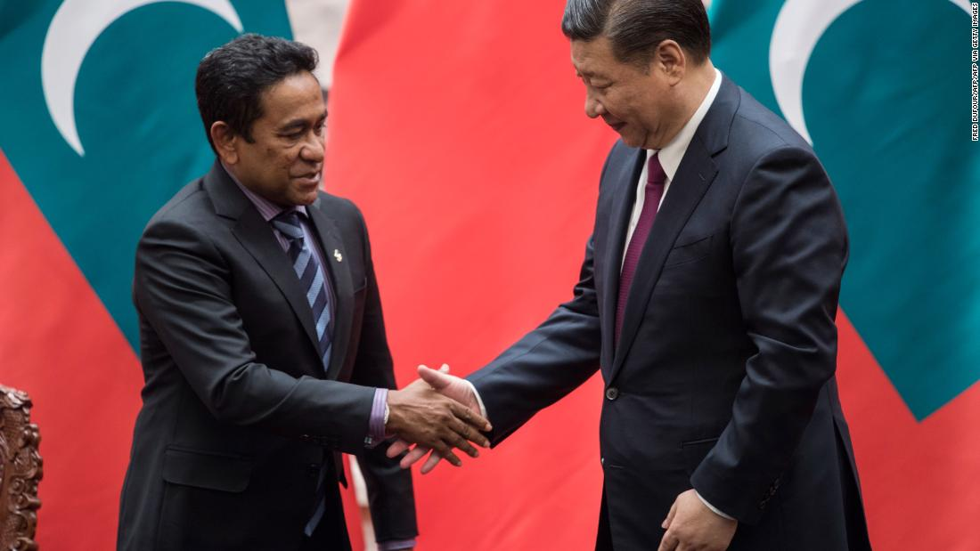 Former Maldives President Abdulla Yameen (L) shakes hand with Chinese President Xi Jinping after a signing ceremony at the Great Hall of the People in Beijing in December 2017.