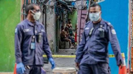 Security personnel in Malé stand guard outside a residential area for Bangladeshi workers, who were placed under coronavirus quarantine in May.