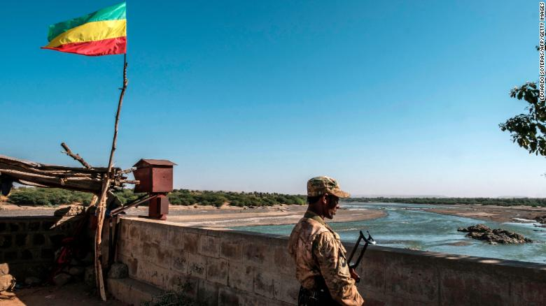 A member of the Amhara Special Forces watches on at the border crossing with Eritrea where an Imperial Ethiopian flag waves, in Humera, Ethiopia, on November 22.