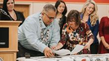Wiyot Tribal Chair Ted Hernandez and Eureka, California, Mayor Susan Seaman sign the deed transferring the city's land on Duluwat Island to the Tribe.