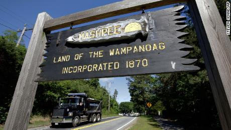 A wooden sign advises motorists of the location of Mashpee Wampanoag Tribal lands in Massachusetts.