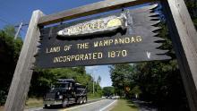 A wooden sign advises motorists of the location of Mashpee Wampanoag Tribal lands in Massachusetts.